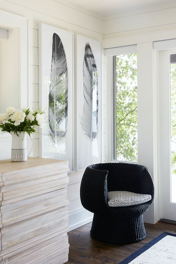 black woven chair with round back and arm rest, grey cushion, wooden floor, wooden cabinet, white wall white ceiling