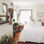 Boho Bedroom, Wooden Floor, Warm Rug, White Bedding, White Wall, White Ceiling, Plants On The Floor, Foating Shelves, Guitar