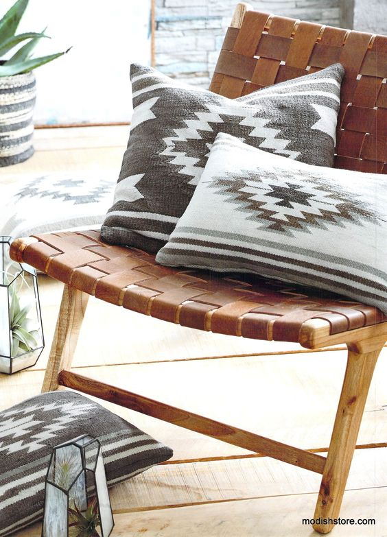 brown leather woven with wooden legs, wooden floor