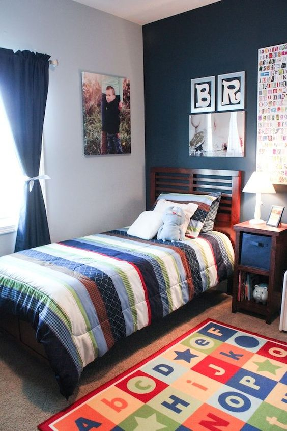 children's room, colorful rug, white wall, blue wall, stripes bedding, wooden platform, side table, white lamp, blue curtain