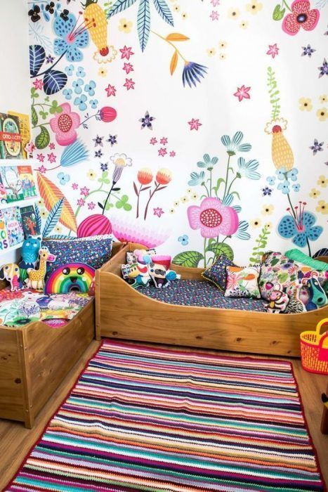 children's room, wooden floor, colorful stripes rug, colorful wallpaper, wooden beds with colorful bedding