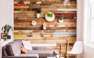 colorful reclaimed wooden accent wall, white painted wall, white rocking chairs, coffee table, grey sofa,