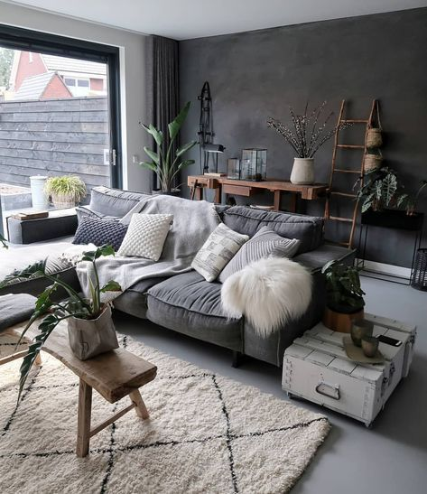 dark small living room, grey floor, grey sofa, white rug, white side table, dark grey wall, white wall, large glass sliding door, wooden bench
