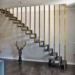 Dark Wooden Stairs, Golden Metal Railing, Dark Woodne Floor, White Wall