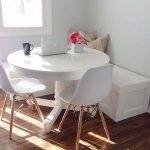 Dining Corner With White Corner Bench, White Round Table, White Mid Century Modern Chairs