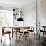Dining Room, Grey Floor, White Open Brick Wall, Black Pendant, Wooden Oval Dining Table, Wooden Chair With Black Cushion, Black Chair
