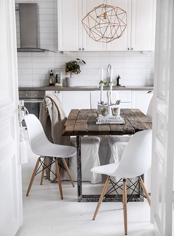 dining room, white floor, white subway backsplash tiles, white cabinet, white modern midcentury chairs, wooden square table, geometric wire pendants