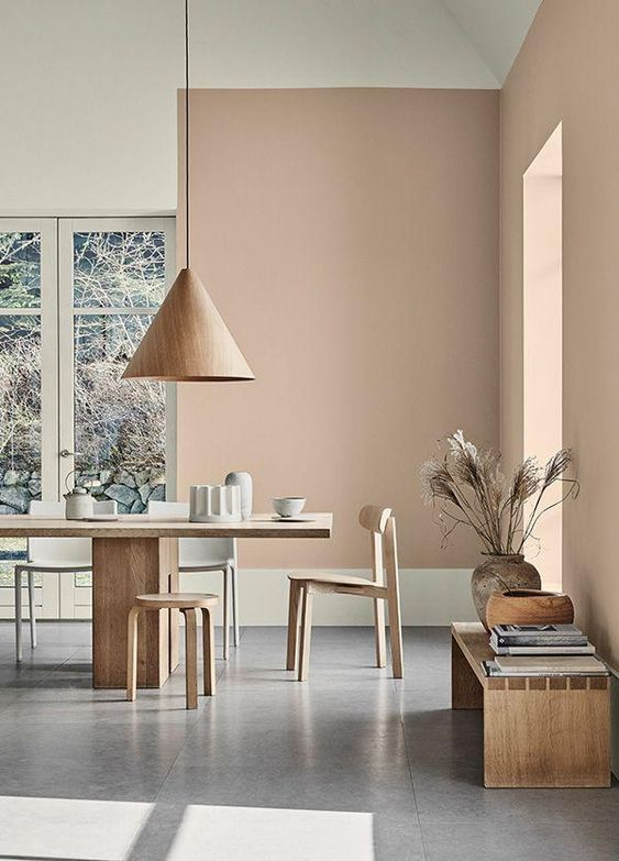 dining room, white wall, light grey terracotta wall, light wooden dining table set, brown cone pendant, wooden bench