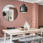 Dining Room, Wooden Floor, Light Wooden Rectangualar Table, Black Bench, Chairs, Black Cover Pendant, Round Mirror, White Ceiling