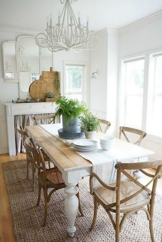 dining room, wooden floor, rug, wooden rattan chair, wooden square table, white wall, white ceiling, white fireplace