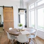 Dining Room, Wooden Floor, Wooden Round Table, White Modern Chairs, White Wall, Large Glass Window, White Bulbs In Tied