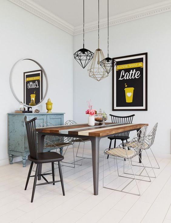 dining room, wooden floor, wooden table, mixed chairs, white wall, blue cabinet, geometric wire pendants, roudn mirror