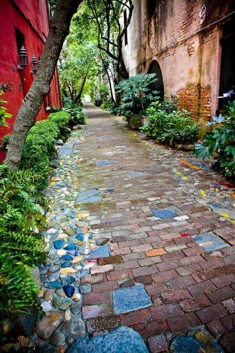 earthy tiles, blue pebbles framed, plants, red building, old building