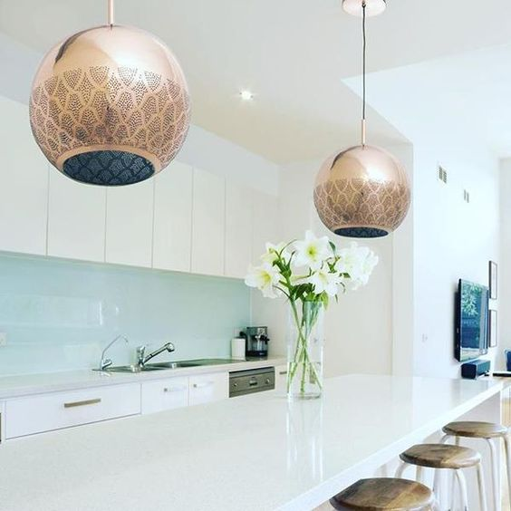 golden moroccan pendants, white island, stools, white cabinet, blue glass backsplash
