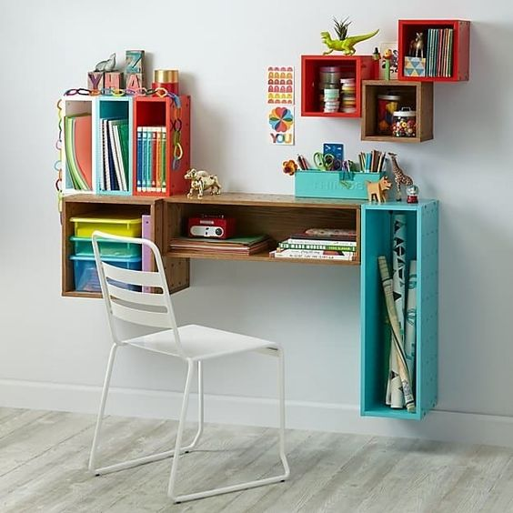 home office area, floating boxes in diffrent color, size, and shapes, white wall, white chair