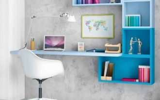 home office area with floating table and shelves in blue, white office char, white table lamp