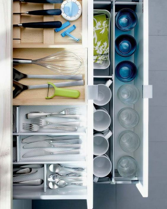 inside of a drawers with kitchenware on top and glasses on the bottom