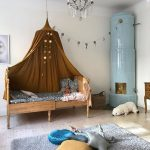 Kids Bedroom, Grey Rug, Wooden Sliding Bed Platform, Brown Canopy, Blue Fireplace, White Wall, Chandelier