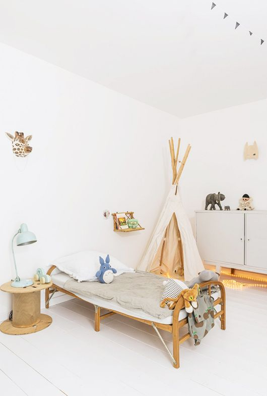 kids bedroom, white floor, white wall ceiling, white wooden cabinet with sliding door, tent, wooden bed platform, white bedding, wooden side table