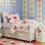 Kids Bedroom, Wooden Floor, White Iron Bed, Blue Wall, Wall Decoration, Flower Bedding, White Bedside Table, White Basket