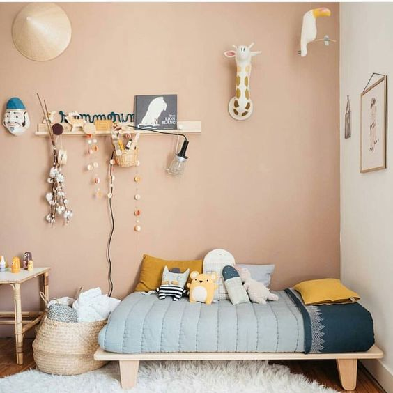 kids bedroomm, brown wall, wooden floor, wooden flat bed platform, rattan basket, bamboo wooden table, wall decoration