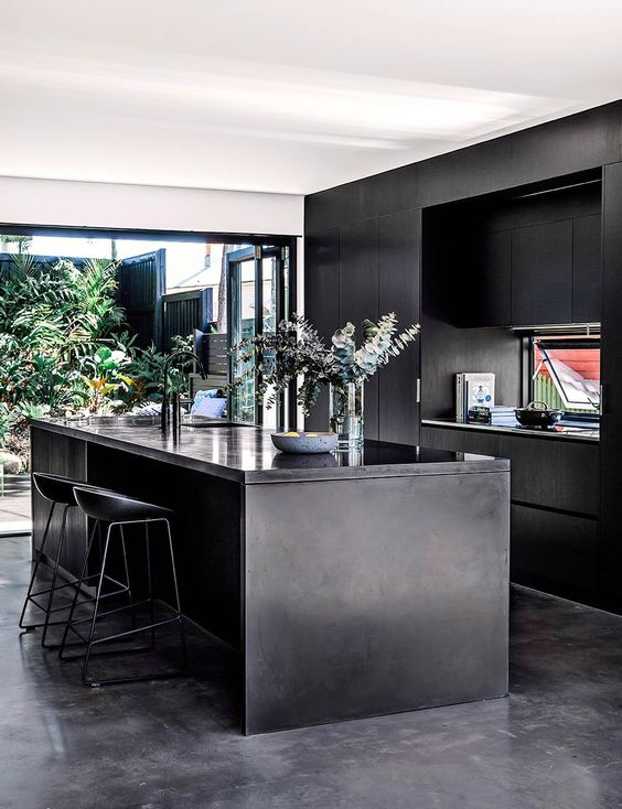 kitchen, black floor, black wooden cabinet, black kitchen top, glass window on stove wall, black island, black stool