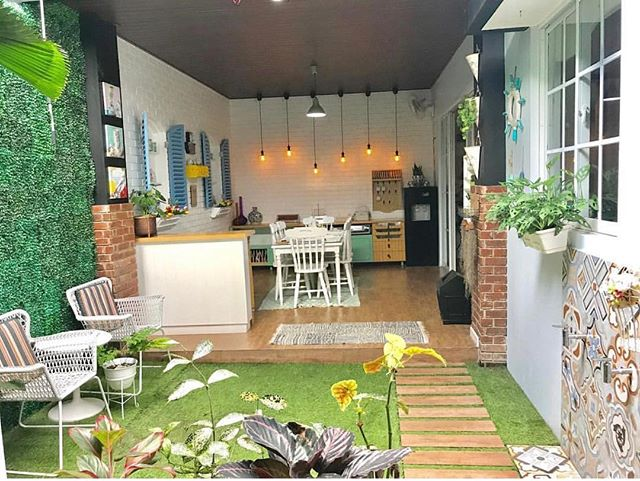 kitchen dining room in open half open space with wooden floor, white wall, white dining set, garden with wooden pathway, patterned tiles, white patio chairs