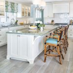 Kitchen, Light Wooden Floor, White Cabinet, White Wooden Island, White Wall, White Subway Backsplash ,rattan High Shairs Blue Cushion, Blue Marble Top
