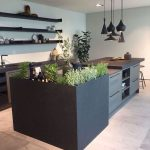 Kitchen, Marble Floor Tiles, Off White Wall, White Ceiling, Black Cabinet, Floating Shelves, Black Island, Plants On The Island, Black Modern Pendants