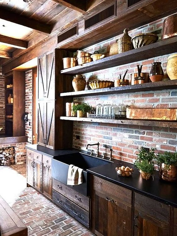 kitchen, open brick wall and floor, wooden glossy cabinet and floating shelves, black countertop, wooden ceiling
