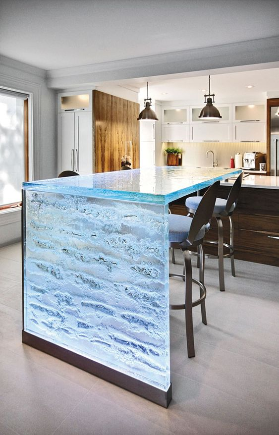 kitchen, white floor tiles, blue glass island, wooden cabinet, wihte counter top, white cabinet, pendants, metal stool with blue cushions