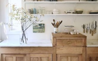 kitchen, wooden cabinet with risen wooden drawer, white wooden floating shelves, white marble counter top, white wall