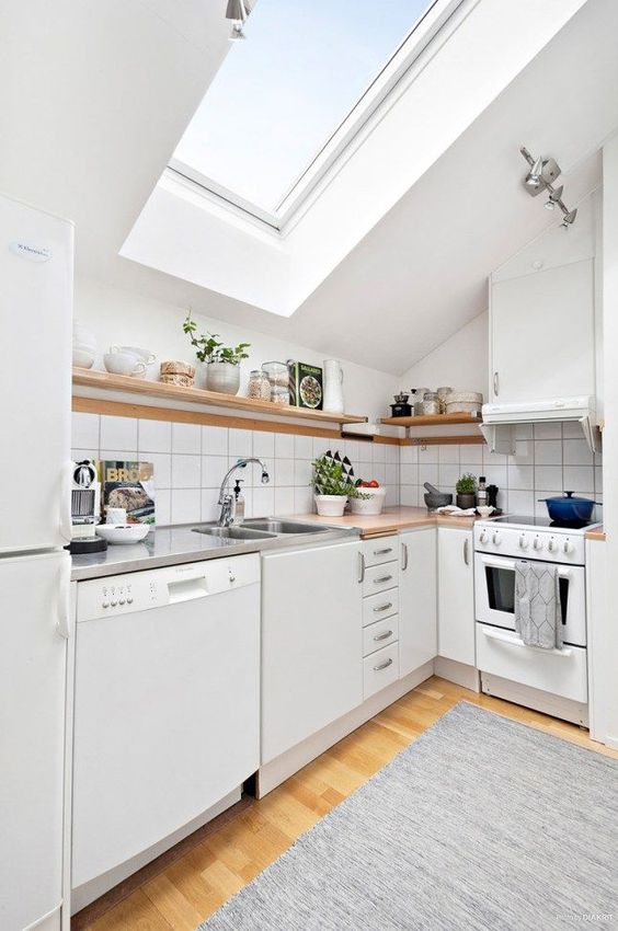 kitchen, wooden floor, grey rug, white cabinet, wooden top, white tiles backsplash, white ceiling, glass windows ceiling