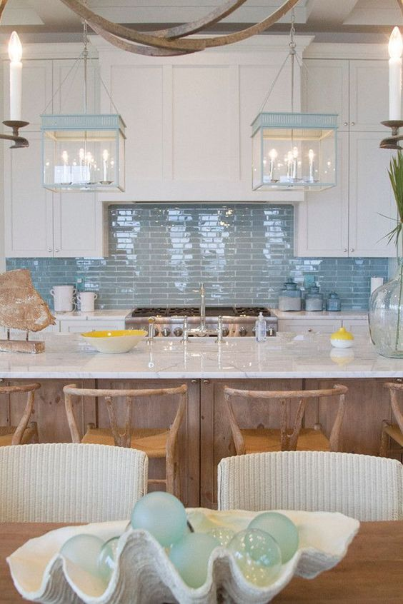kitchen, wooden table, wooden island with white marble top, white cabinet, blue backsplash, wooden chairs, white chairs