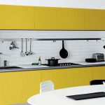 Kitchen, Yellow Botoom And Upper Cabinet, White Subway Backsplash, Silver Counter Top, Silver Rail, White Round Dining Table With Chairs