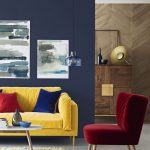 Living Room, Dark Grey Wall, Light Grey Floor, Yellow Velvet Sofa, Red Velvet Chair, Rug, White Round Coffee Table