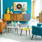 Living Room, Grey Floor, Brown Sofa, Tosca Velvet Chair, Blue Rug, Colorful Nesting Table, Brown Side Table, Wooden Cabinet With Yellow Grey Door, Blue Wall, Yellow Decor