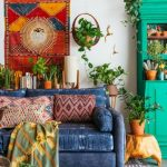 Living Room, Grey Rug, Dark Blue Sofa, Geometric Pillows, Green Cupboard, Plants, Wooden Side Table, Orange Wall Decor