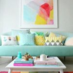 Living Room, White Floor, Colorful Stripes Rug, White Wall, Baby Blue Sofa, White Square Low Coffee Table, Colorful Pillows, Colorful Painting
