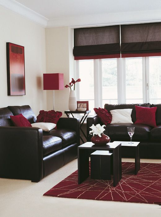 living room, white floor, dark brown leather sofa, dark wooden coffee table, white wall, red rug, red floor lamp,