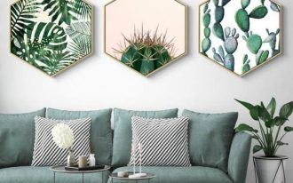 living room, white floor tiles, white wall, green sofa, round nesting table, wall decoration