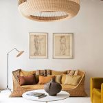 Living Room, White Floor, White Wall, Brown Rug, White Round Coffee Table, Rattan Sofa With Cushion, Mustard Chair, Natural Pendant, Rattan Floor Lamp, Wooden Ceiling
