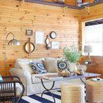 Living Room, Wooden Floor, Wooden Planks Wall, Grey Sofa, Black Rattan Chair With Grey Cushion, Rattan Ottoman Storage, Coffee Table, Window