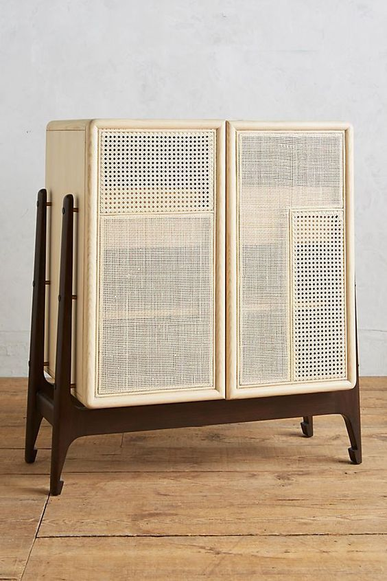 low cupboard with wooden rattan boxes supported in u wooden legs