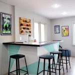 Modern Bar, Wooden Floor, White Wall, White Ceiling, White Blue Island With Black Top, Black Stools, Ceiling Lamp