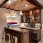 Modern Glossy Bar, Wooden Island, Silver Top, Dark Floor Tiles, Beige Floor, Silver Metalic Frame On The Ceiling With Wood In The Middle, Pendants, Wooden Cabinets, Silver Stools