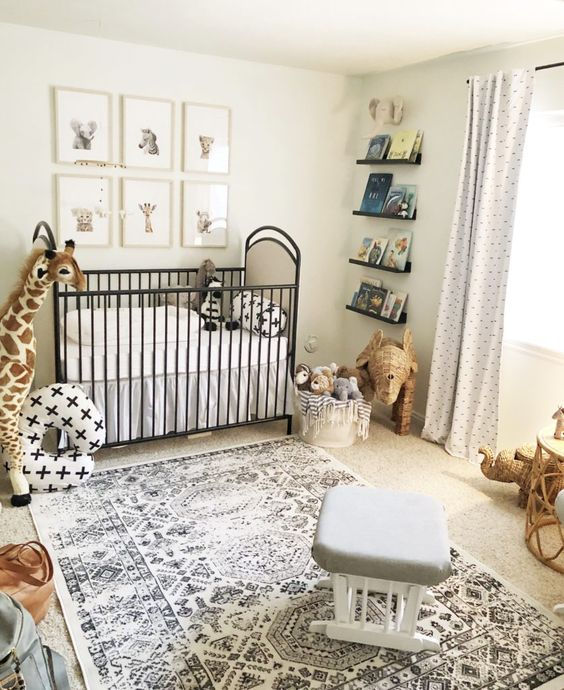 nursery, beige floor, rug, grey ottoman, rattan toys, stuffed animals, cribs, animals' pictures, floating shelves, white curtain