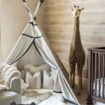 Nursery, Gey Rug Flooring, Wooden Wall, Beige Wall, Wooden Low Crib, Grey Chair, Tall Stuffed Giraffe