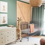 Nursery, Wooden Floor, White Rug, Animal Pattern Rug, White Cabinet, Green Wall, Wooden Accent Wall, Green Curtain, Rattan Conver Chandelier