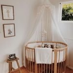 Nursery, Wooden Floor, Wooden Round Crib, White Urtain, White Wall, Animals' Pictures, Small Stool